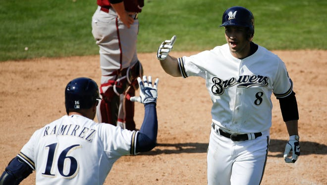 Ryan Braun, right, celebrates his home run with Aramis Ramirez against the Arizona Diamondbacks during the fifth inning of a spring training baseball exhibition game in Phoenix.