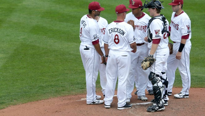 The Wisconsin Timber Rattlers' Luis Ortega talks to manager Matt Erickson and teammates while pitching against the Peoria Chiefs during their baseball game Thursday, July 30, 2015, at Neuroscience Group Field at Fox Cities Stadium in Grand Chute, Wis. 