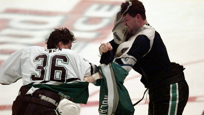 San Jose Sharks Owen Nolan, right, fights with Mighty Ducks of Anaheim's Todd Ewen during the first period of their game Sunday, Feb. 25, 1996, in Anaheim, Calif.