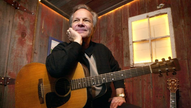 Bobby Vee poses with a guitar in a photo from April 2004.