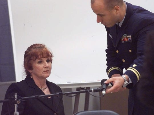 """Elizabeth Helmbrecht, left, driver of the tour boat """"Miss Majestic"""" prepares to testify before a U.S. Coast Guard hearing Tuesday, May 11, 1999, in Hot Springs, Ark. Hembrecht was one of eight survivors; 13 people died."""