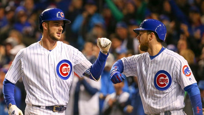 Kris Bryant, left, is congratulated by left fielder Ben Zobrist for hitting a solo home run in the fourth inning.