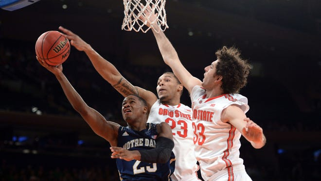 Ohio State Buckeyes center Amir Williams (23) blocks the shot of Notre Dame Fighting Irish guard Demetrius Jackson (23) during the first half of the Gotham Classic at Madison Square Garden.
