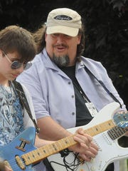 Chris Aaron (right), a longtime Fox Valley blues artist,