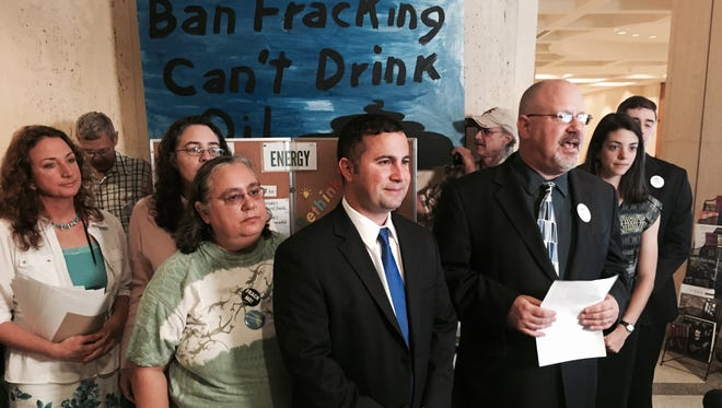 Sen. Darren Soto, D-Orlando (wearing blue tie), gathers with anti-fracking activists at the Capitol.