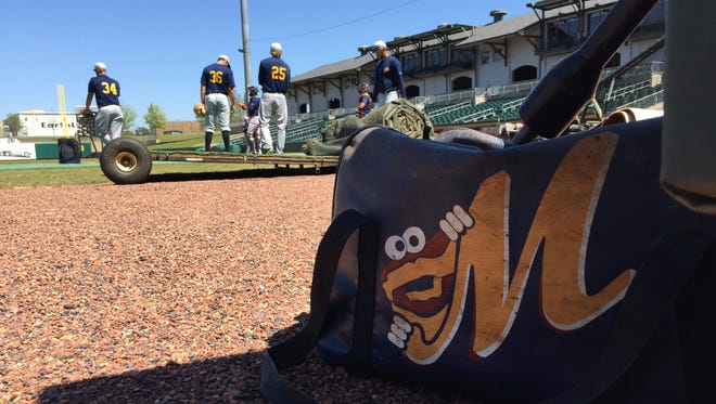 A Montgomery Biscuits ball bag sits on the field.