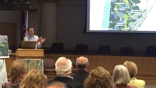Daniel Liggett, a landscape architect, presents the plans for the Wabash River corridor along Ninth Street.