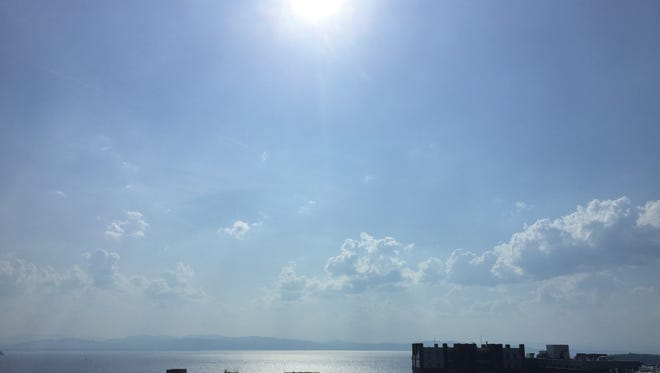 The sun glistens off Lake Champlain on Friday, when the Burlington area tied a weather record set in 1944 of 91 degrees.