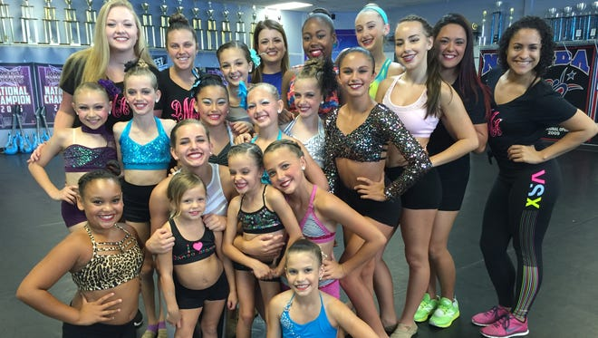 These 15 dancers from Dance Mania in Melbourne (shown with their coaches) will perform the opening act for Kidz Bop on June 17 at the King Center.