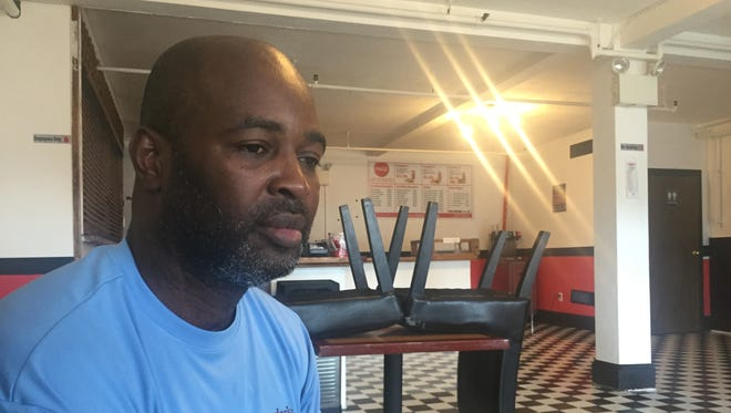 Johnny's Burgers & Malts owner Marvin Johnson said a number of factors contributed to the restaurant's closure, from issues with city police to struggles getting enough customers.