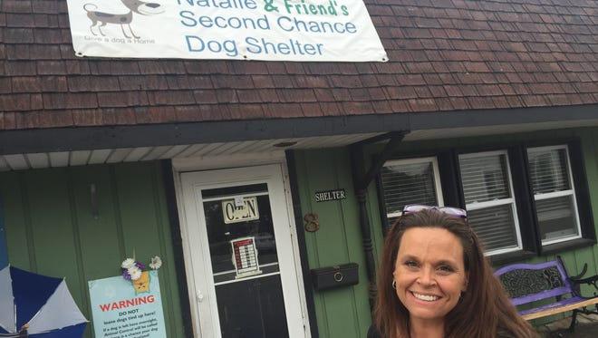 Natalie Moore, owner of Natalie & Friend's Second Chance Dog Shelter, was all smiles Saturday after reaction to a video about her shelter's plight.