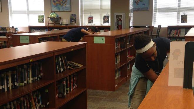 Oak Hammock Middle School has restructured its media center, grouping books together by genre. The change came just in time for a schoolwide reading challenge, which has kept students, like 12-year-old Taliya Martin, on the hunt for her next book.