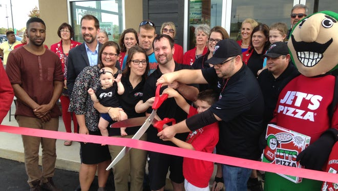 Jet's Pizza held its ribbon cutting at Park Place West on Tuesday. Aaron Roman and wife Kellie and Anthony McGrath and wife Rhonda co-own the restaurant at 9 Chloe Place. They also own Jet's at 406 Oil Well Road.