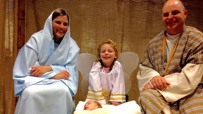 At the Bethlehem Marketplace at First United Methodist Church of Birmingham, the Fields Family with parents Christine and Brad, Emily, 4, dressed as an angel, and Ethan, seven weeks old represented the holy family in a live nativity scene. Over 400 people participated in the hands on event.
