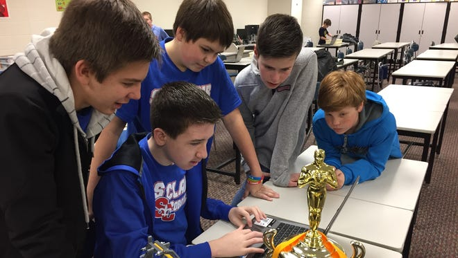 St. Clair Middle School students Spencer Hack, left, Andrew Parr, Raine Caister, Quinn Schwarz and Mitchell Hack won a qualifying tournament for the Michigan Robofest Championships.