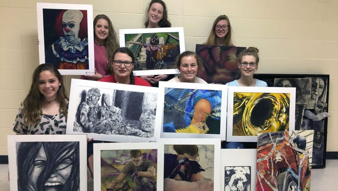 Norfork High School Students who competed at the Arkansas Young Artists Association competition were: (first row, from left) Sydney Lawhorn, Montana Greve, Kelcy Acklin, Makenzie Pennington, (second row) Matty Dillard, Marleigh Dodson and Makayla Dwyer.