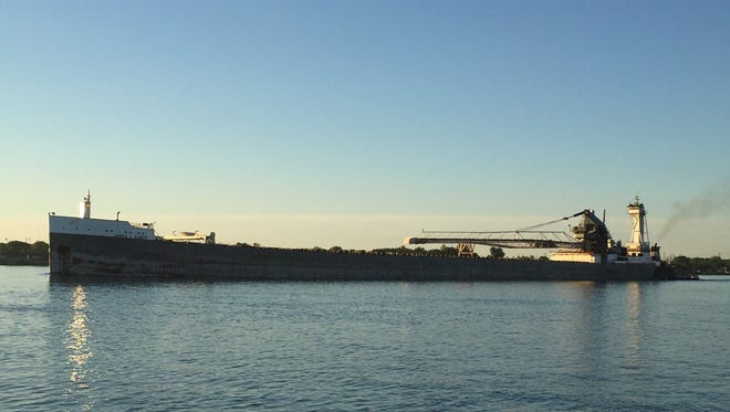 The barge James L. Kuber, pushed by the tug Victory, heads upstream in the bright sunshine near St. Clair.