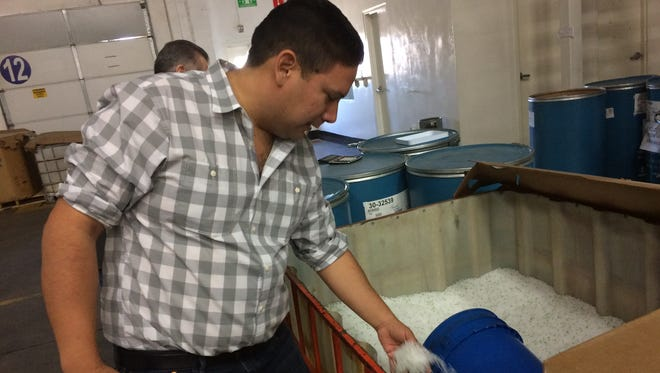 Julian Durazo, general manager for BRH2 Plastics, shows off the resin used to create plastic-molding products in the 75,000-square-foot factory in Hermosillo, Mexico. Clients include Boon, a baby-products company, as well as Ford, which assembles the Ford Fusion in that city.