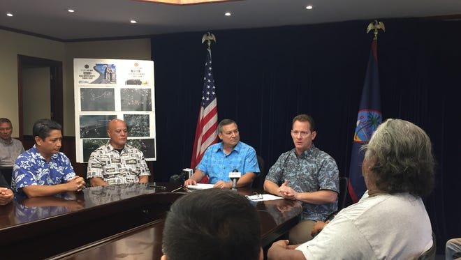 Gov. Eddie Calvo and Lt. Gov. Ray Tenorio announced about $8 million will fund repairs of 16 miles of village roads in the coming months at a bill signing ceremony for Bill 122 on Oct. 12, 2017.