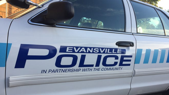 An Evansville Police Department squad car parked on a city street.