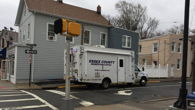 The Essex County Prosecutor's Office van at the scene of a homicide at Hartley Street and Bloomfield Avenue in Montclair.