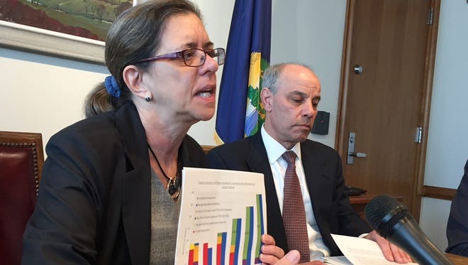 Vermont Administration Secretary Susanne Young explains Gov. Phil Scott's education finance plan at a Tuesday news conference in Montpelier alongside Finance Commissioner Adam Greshin.