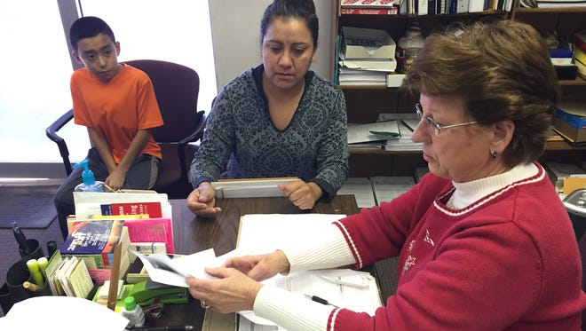 Levita Rohlman Rupp, right, helps Maria Castro fill out immigration paperwork for her daughter, who is renewing her deportation protection under a program created by President Obama in 2012. Castro, an undocumented immigrant, will also qualify for the president's new plan since she has another child who was born in the USA.
