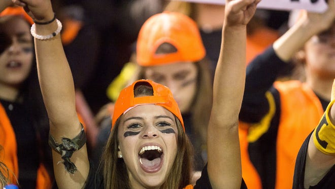 A Tuscola fan cheers on her team during Friday's game at Pisgah.