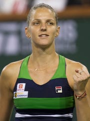Karolina Pliskova celebrates her win over Monica Puig in three sets during their second round match on Stadium 1 during the 2017 BNP Paribas on March 10, 2017.