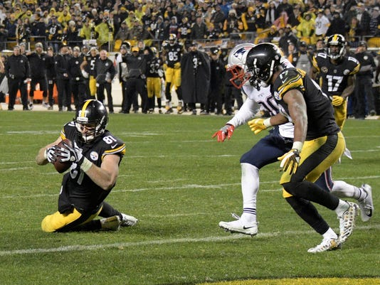 e4b5ef945 Pittsburgh Steelers tight end Jesse James (81) has a knee down before  crossing the goal line with a pass from quarterback Ben Roethlisberger  during the ...