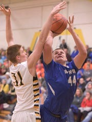 Wynford's Caleb Rausch attempts a shot over Colonel