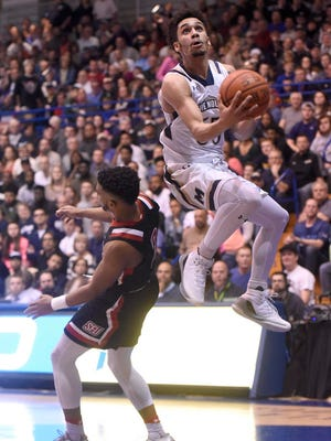 Mount St. Mary's guard Elijah Long, right, shoots against St. Francis guard Jamaal King in the first half.