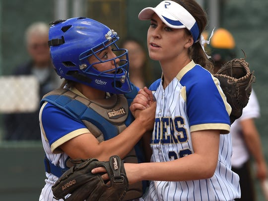 Reed catcher Rheanna Smith, left, and and pitcher Julia Jensen share a moment in the regional championship game against Bishop Manogue on Saturday