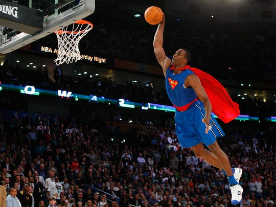 Dwight Howard, with Superman outfit, wins the NBA dunk