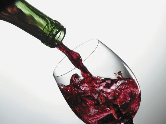 Wine poured into glass.