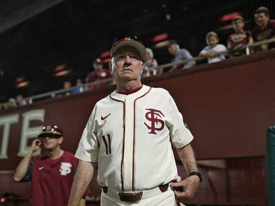 FSU Head Coach Mike Martin walks out on to the field after career win 1,975, tying him for most all-time, as the Seminole's defeat the Hurricanes 10-1 at Dick Howser Stadium on Saturday, April 28, 2018.