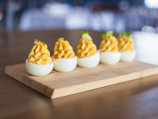 Deviled eggs topped with fresh herbs are available