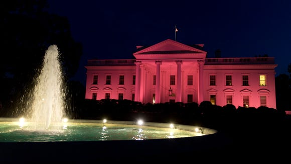 The White House is illuminated pink Thursday to recognize