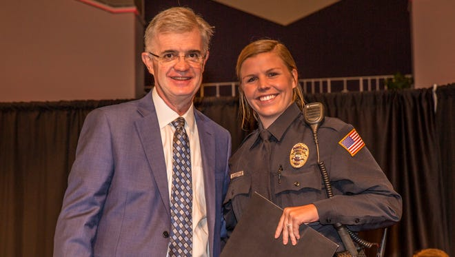 Recent Collierville police hire Nora Harvey won top academic awards in her class at the Tennessee Law Enforcement Training Academy. Appearing with her at a ceremony is Walter Butler of Bethel University.