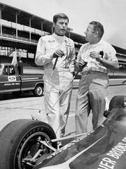 "Actor Robert Wagner (left) talks to Rodger Ward, two-time winner of the Indy 500 during a break in the filming of ""Winning"" at the Indianapolis Motor Speedway in 1968. Ward served as technical advisor. They were also in a pro-am golf tourney."