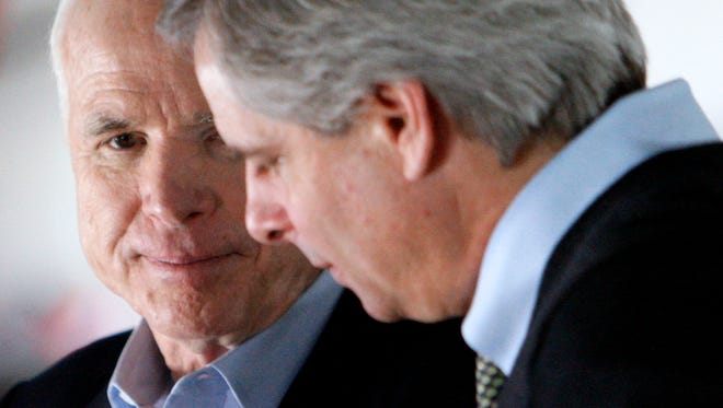Sen. John McCain, R-Ariz., left, talks to longtime political adviser Rick Davis on Feb. 6, 2008. Davis remains in McCain's inner circle, but McCain has yet to name a campaign manager for his 2016 re-election bid.