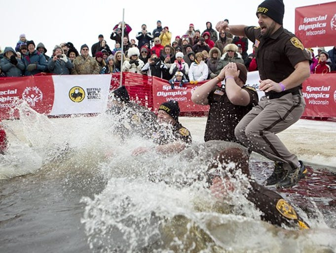Wood County Special Response Team takes the first plunge during the Wisconsin Rapids Polar Plunge for Special Olympics at Anchor Bay Bar and Grill in Biron, Saturday, Feb. 8, 2014.