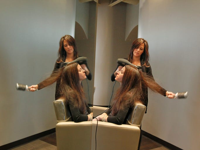 Stylist Tanya Berends gives a blow out to client Shey Slater, Brighton, at W salon, 3246 Monroe Ave. in Pittsford Friday, Nov. 15, 2013.   The Dry Bar express treatment is very popular in New York City and is now making its way to Rochester.
