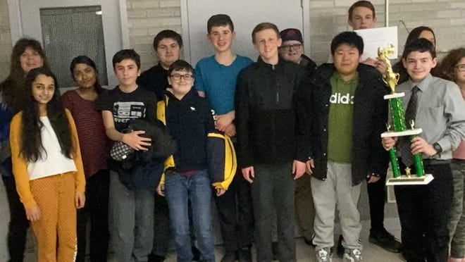 Members of the RJK Middle School Math Team, with their trophy after recently earning the section D championship for the Mid-Hudson Valley Jr. High Math League.