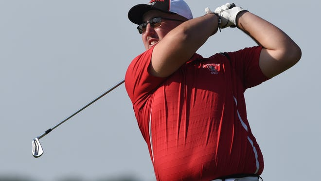 Coshocton's Mason Waycaster hits a tee shot at River Greens on Monday during the East District Golf Sectionals.