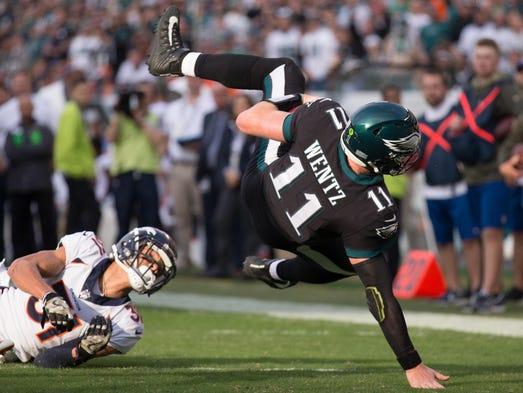 Philadelphia Eagles quarterback Carson Wentz is tackled