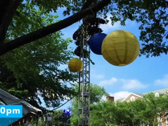 University of Delaware officials released this photo Wednesday morning, saying it shows paper lanterns hanging during and event earlier this month in the same tree near Mitchell Hall on The Green where remnants of the lanterns – hanging strings and metal wires – initially were mistaken Tuesday night for nooses and investigated as a hate crime.