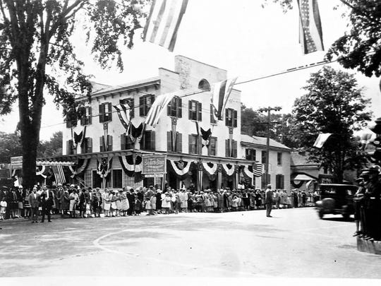 The hotel, seen on Parade Day in the late 1920s, was called Tyler's Inn at that time.
