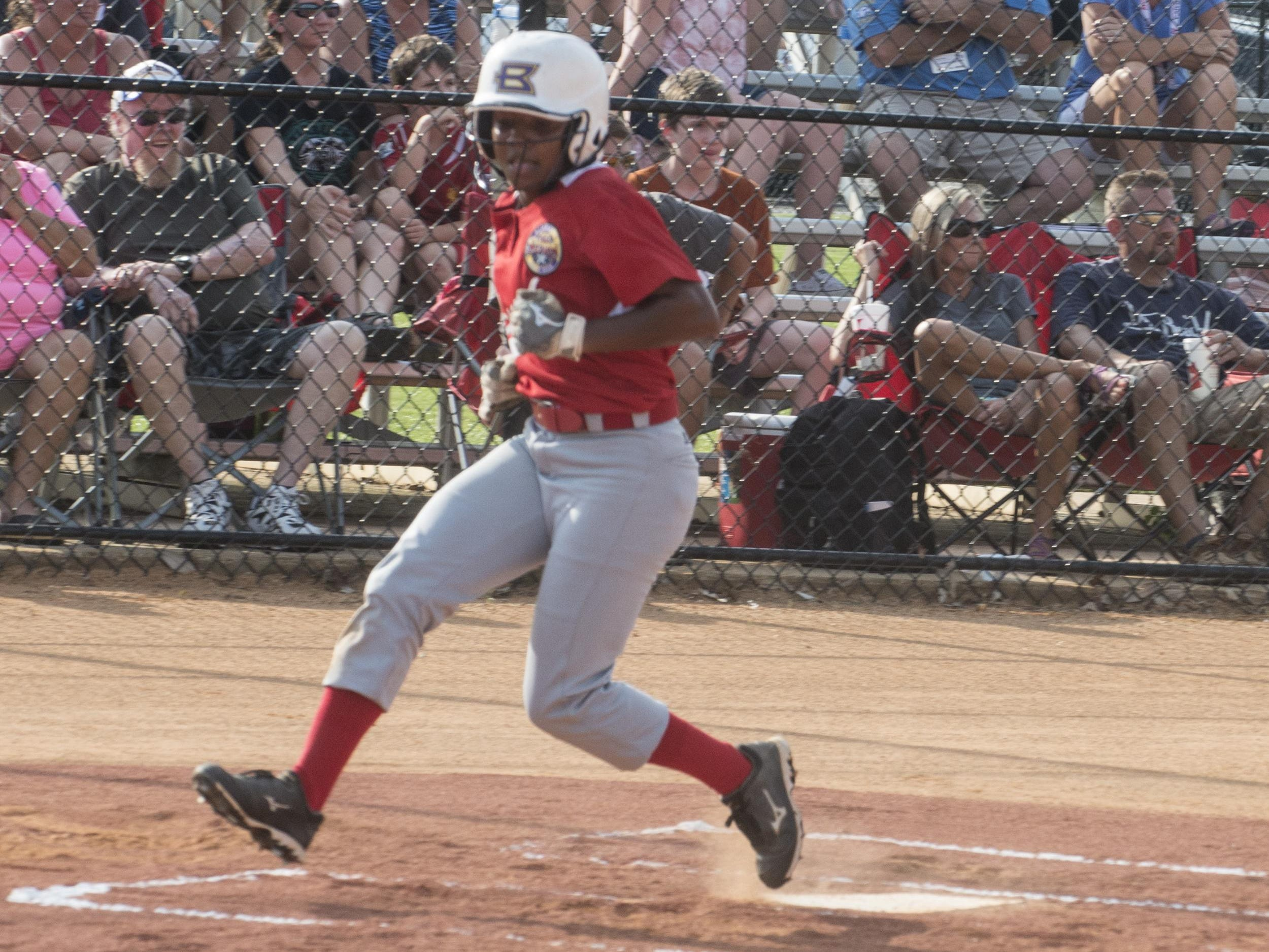 Elmore County player Elissa Brown of the South All-Stars team crosses the plate to score. The South All-Stars team took a 4-3 win in game 1 over the North team on Tuesday, July 21, 2015, at Lagoon Park in Montgomery.