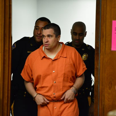 Michael Marrara, of Fort Lee, is brought into the courtroom
